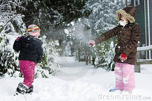 two-kids-having-snowball-fight-18897591